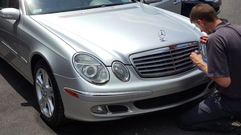 Detailing the grill of a Mercedes
